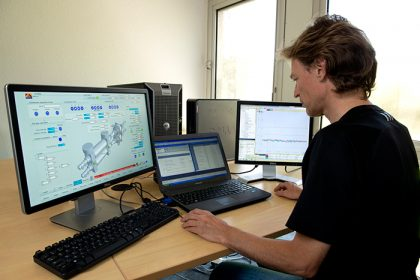 One Novelis PAE engineer, designing the supervision software of a continuous twin roll strip caster.