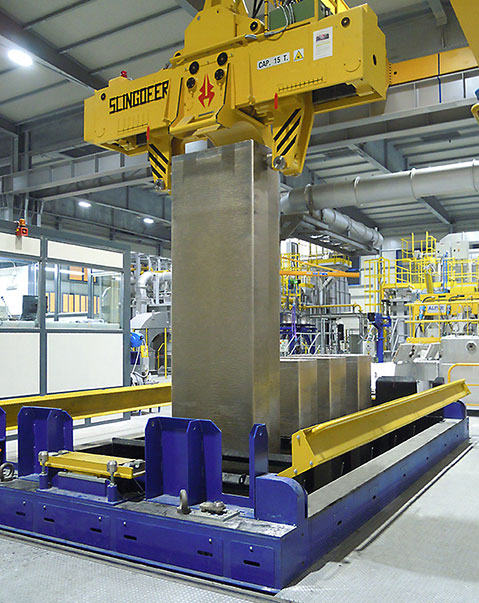Removal of a slab from the vertical dc casting machine by the Client's grab