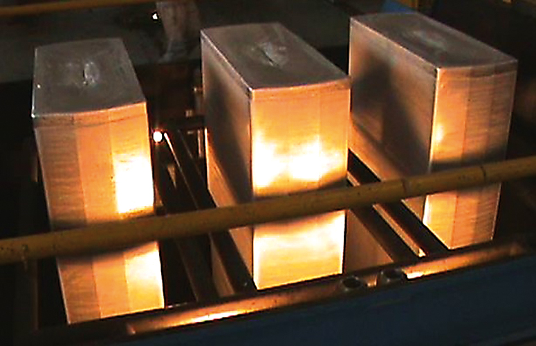 Three slabs of hard alloy just cast in the machine after the casting table has been transferred by the trolley to its maintenance station